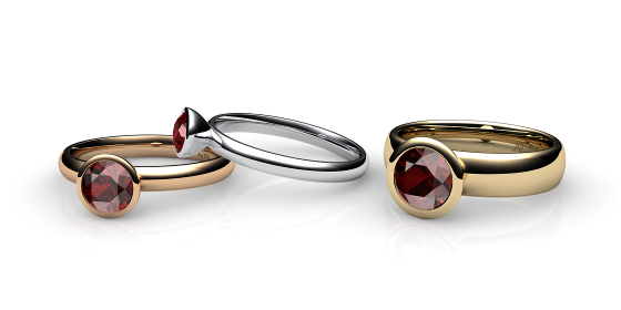 Melody. Bezel set almandine garnet ring