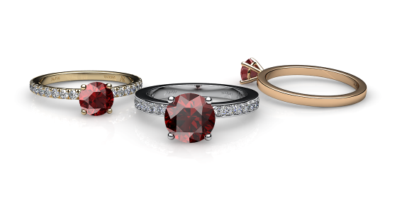 Iris. Prong-set almandine garnet solitaire ring