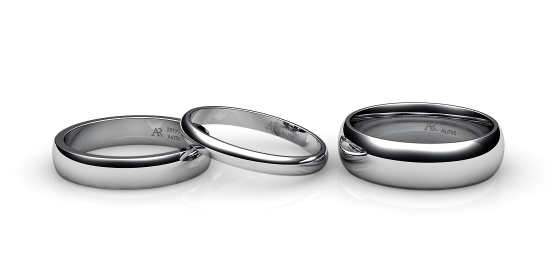 Flamenco. Domed wedding band in white gold