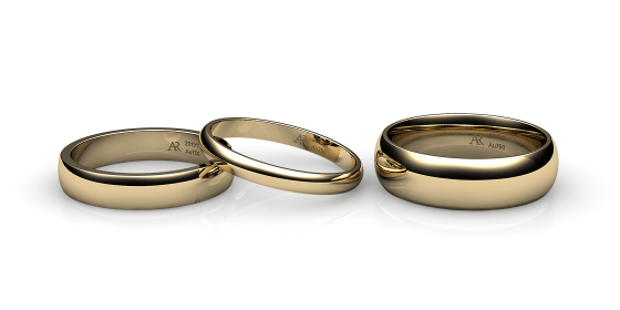 Flamenco. Domed wedding band in yellow gold