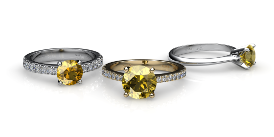 Betelgeuse. Prong-set yellow sapphire solitaire ring