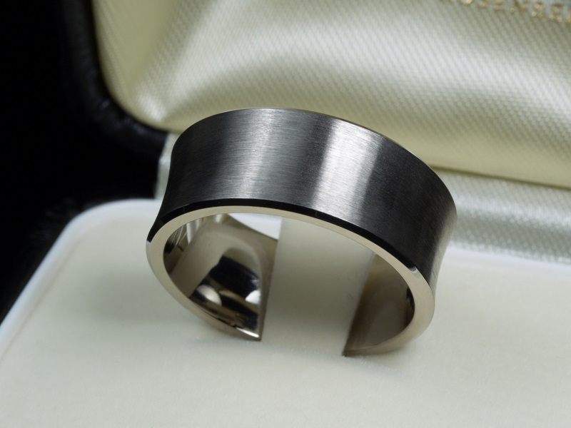 Personalized 9 mm concave men's wedding ring with brushed top surface. Gray gold, without rhodium plating.