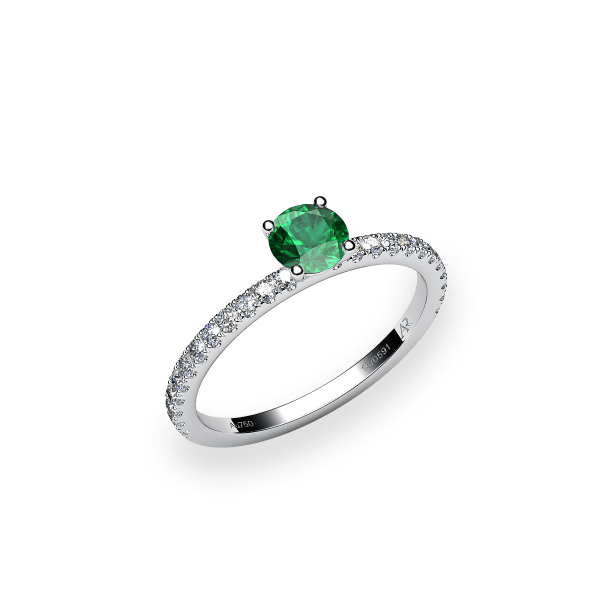 Iris. Prong-set emerald solitaire ring